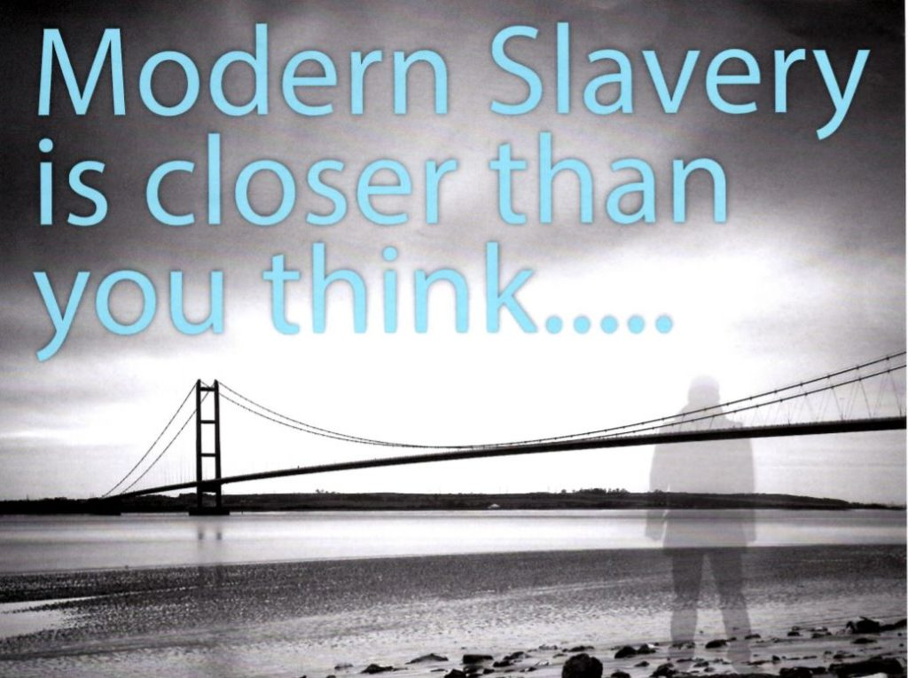 Image of shadowy figure next to Humber Bridge with the caption